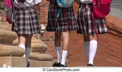 Female Students With Backpacks