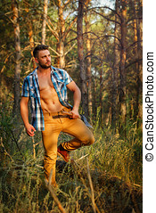 Lumberjack with ax walking through forest Woodcutter in...