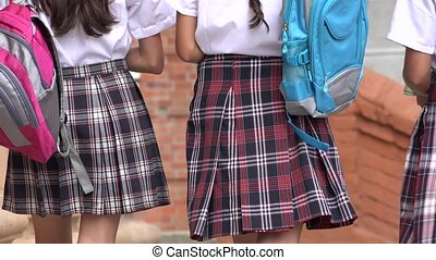 School Girls Walking With Backpacks