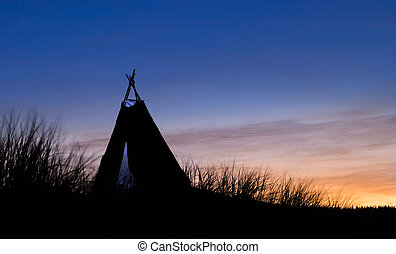 Tepee Morning Light - Tepee tent on a hill with dawn light...