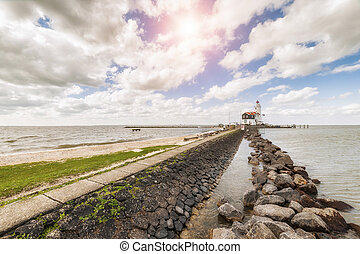 Lighthouse on Bank - Landscape with lighthouse on bank,...