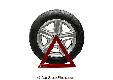 automotive wheel with an emergency sign on a white...