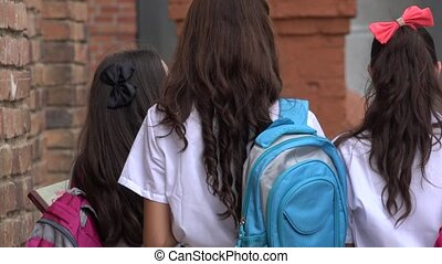 Female Teen Students With Backpacks