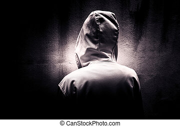 Stranger in the dark - Back side of mysterious woman wearing...
