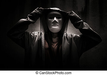 Stranger in the dark - Mysterious woman wearing white mask...