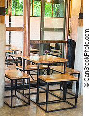 Empty cafe tables and chairs, stock photo