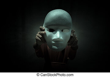 Clown white mask - Mysterious person showing white mask in...