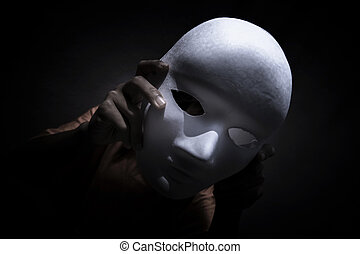 Clown - Mysterious person showing white mask in the...