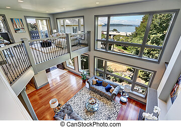 Panoramic view of elegant grey living room from upstairs....