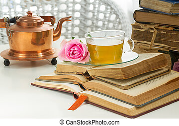 Cup of tea with books - Cup of tea in glass with old books,...