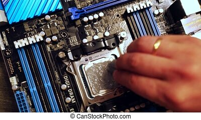 Technitian applies thermal paste on CPU. 3840x2160. 4k
