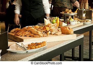 buffet tables with finger food apetizers