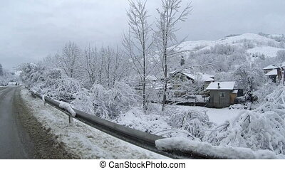 Snow covered village - View of a snow covered village in the...