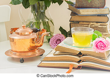 Cup of tea with books - Summer teatime - cup of tea in glass...