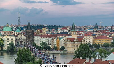 Scenic summer aerial view of the Old Town pier architecture and Charles Bridge over Vltava river timelapse in Praha. Prague, Czech Republic.