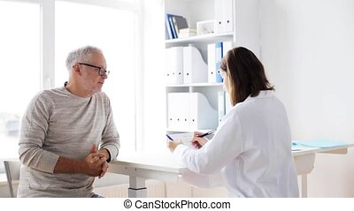 senior man and doctor meeting at hospital 37 - medicine,...
