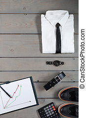 Businessman, work outfit on grey wooden background. White...