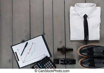 Businessman, work outfit on grey wooden background White...