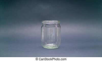 Woman Puts Euro 500 into a Glass Jar for Storage. Slot glass...