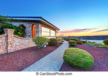 Luxury house exterior at sunset. Perfect landscape design....