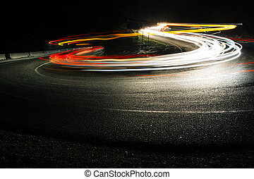 Bright car lines on night road