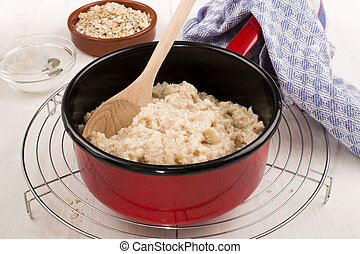 with water boiled irish steel cut oats in a pot - with water...