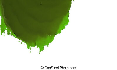 green paint flowing down in slow motion. colored oil -...