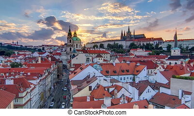 sunset behind St Nicolas timelapse in Mala Strana in Prague....