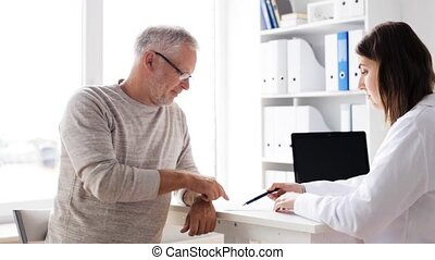 senior man and doctor meeting at hospital 61 - medicine,...