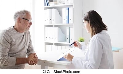 senior man and doctor meeting at hospital - medicine, age,...