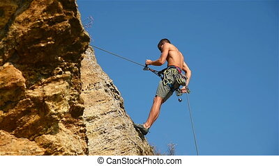 Climber Descends On A Rope - Extreme Climber Descends On A...