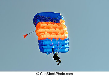 Skydiver on parachute - Paraglider flying on colorful...
