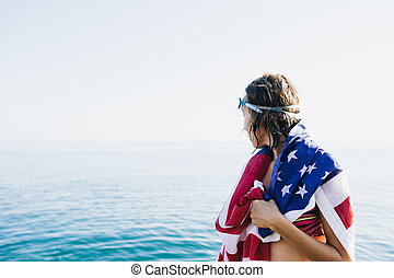 Back view of wet-haired woman in american flag