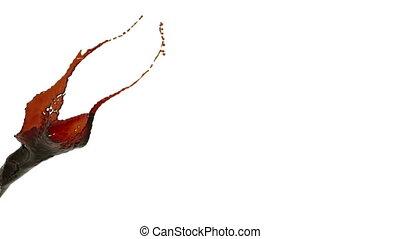 orange color splash slow motion. colored oil - close-up view...