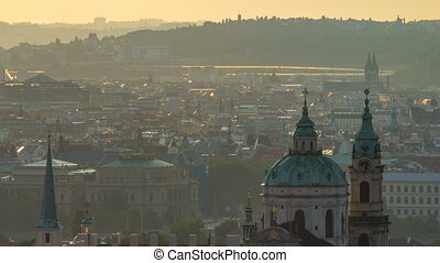 Spires of the old town and St Nicolas church at sunrise timelapse. czech republic, prague