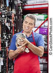 Happy Salesman Looking At Rabbit In Pet Store - Happy mature...
