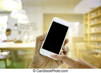 hand hold and touch screen smart phone on blurred man with...