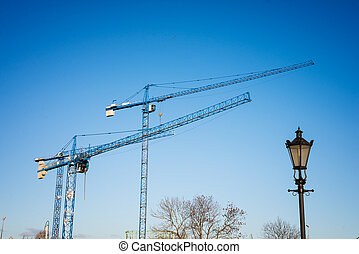 cranes - construction cranes against a blue sky