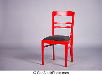 red chair on a gray background