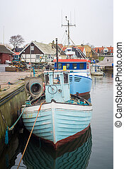 fishing vessels stand in the harbor in Sweden