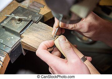 jeweler fixes gems on gold product
