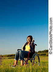 Handicapped woman on wheelchair - Handicapped woman on a...