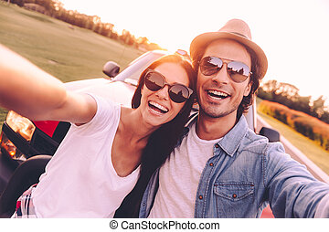 We love selfie! Beautiful young couple bonding to each other...