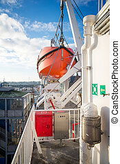 lifeboat on a big ship at day