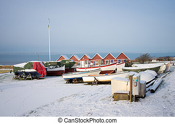 boats near the coast in the snow