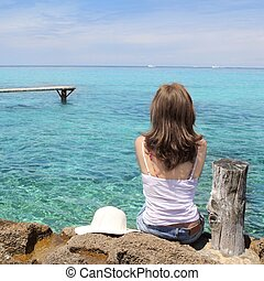Tourist back woman looking Formentera turquoise sea Illetes...