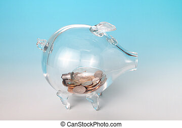 Light bulb in piggy bank - Glass piggy bank with an old...