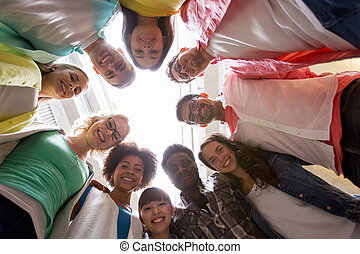 group of international students standing in circle -...