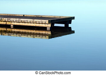 Jetty on lake - Rustic jetty on a zen-like idyllic lake in...