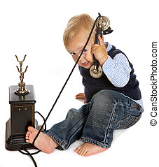 Toddler with antique telephone - Blonde toddler boy playing...